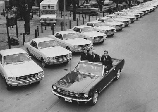Donald Frey, Lee Iacocca and Henry Ford II at the New York World's Fair first anniversary of the Mustang on April 15, 1965.