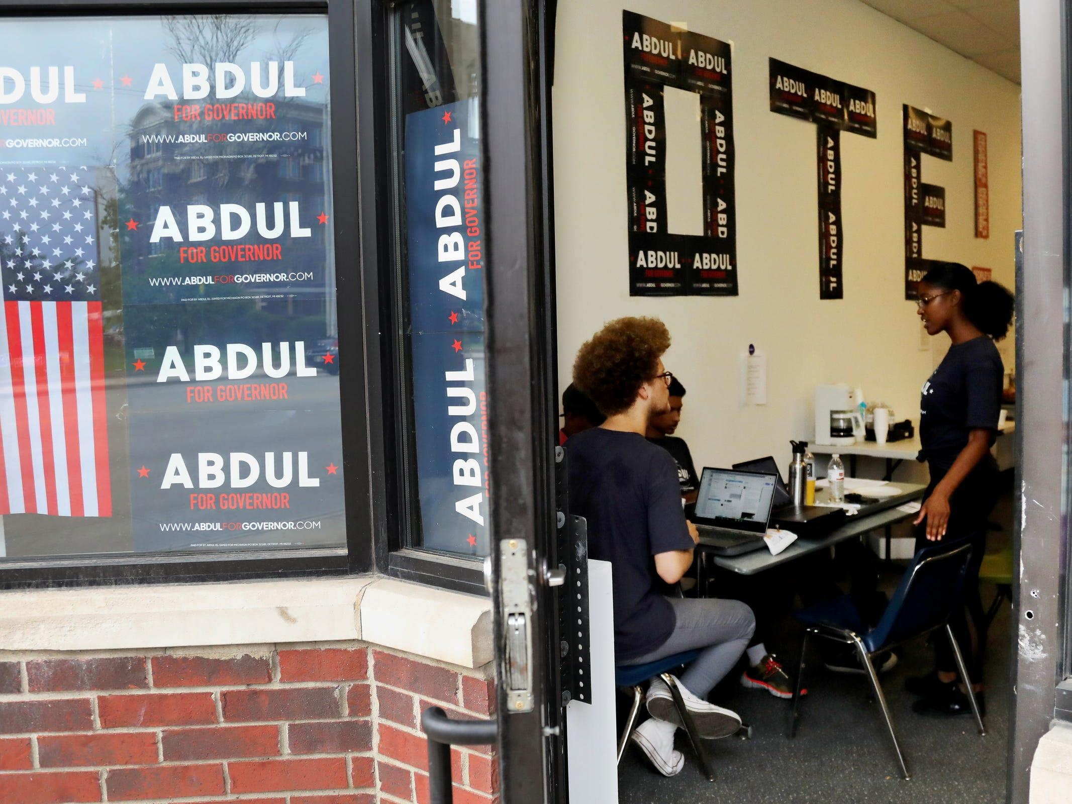 Camille Johnson, lead Detroit organizer, talks with other organizers at the campaign headquarters for Dr. Abdul El-Sayed in Detroit on Tuesday, Aug. 7, 2018.