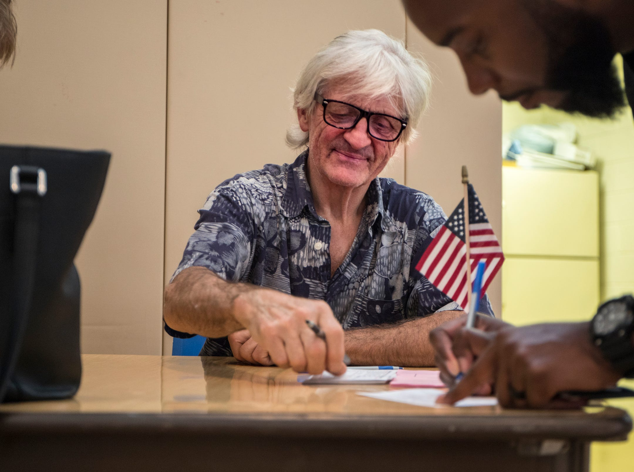 Ray DiMeo, 67 of Mt. Clemens volunteers as an inspector at the Wilson Gymnasium polling location in Mt. Clemens, Mich., Tuesday, August 7, 2018.