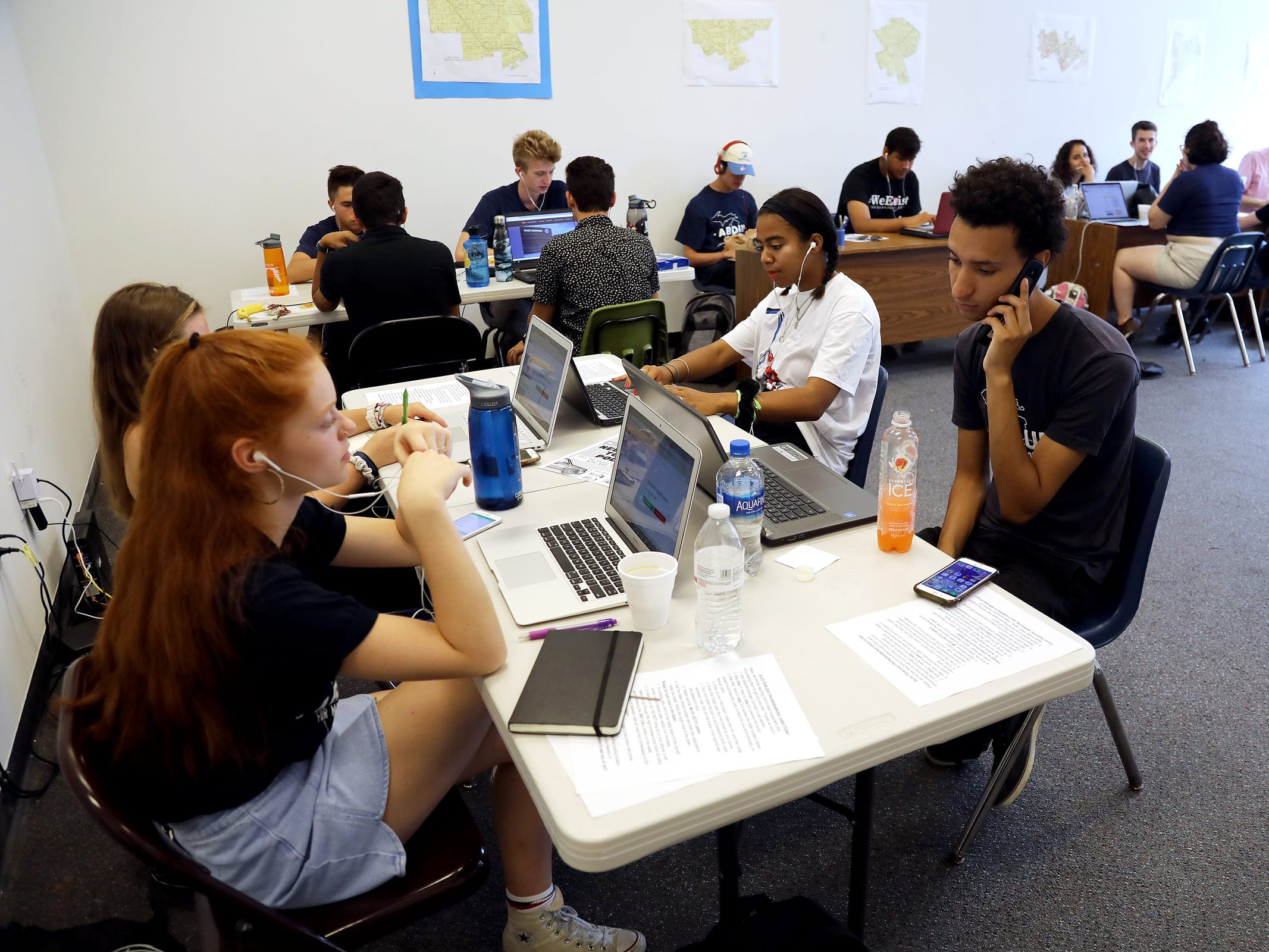 Volunteers make phone calls to voters on Michigan Primary at the campaign headquarters for Dr. Abdul El-Sayed in Detroit on Tuesday, Aug. 7, 2018.