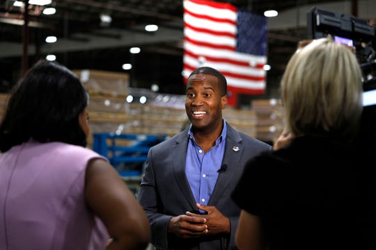 John James, Michigan GOP Senate candidate, does an interview with a news media outlet before holding an election night event at his business, James Group International, August 7, 2018 in Detroit, Michigan.