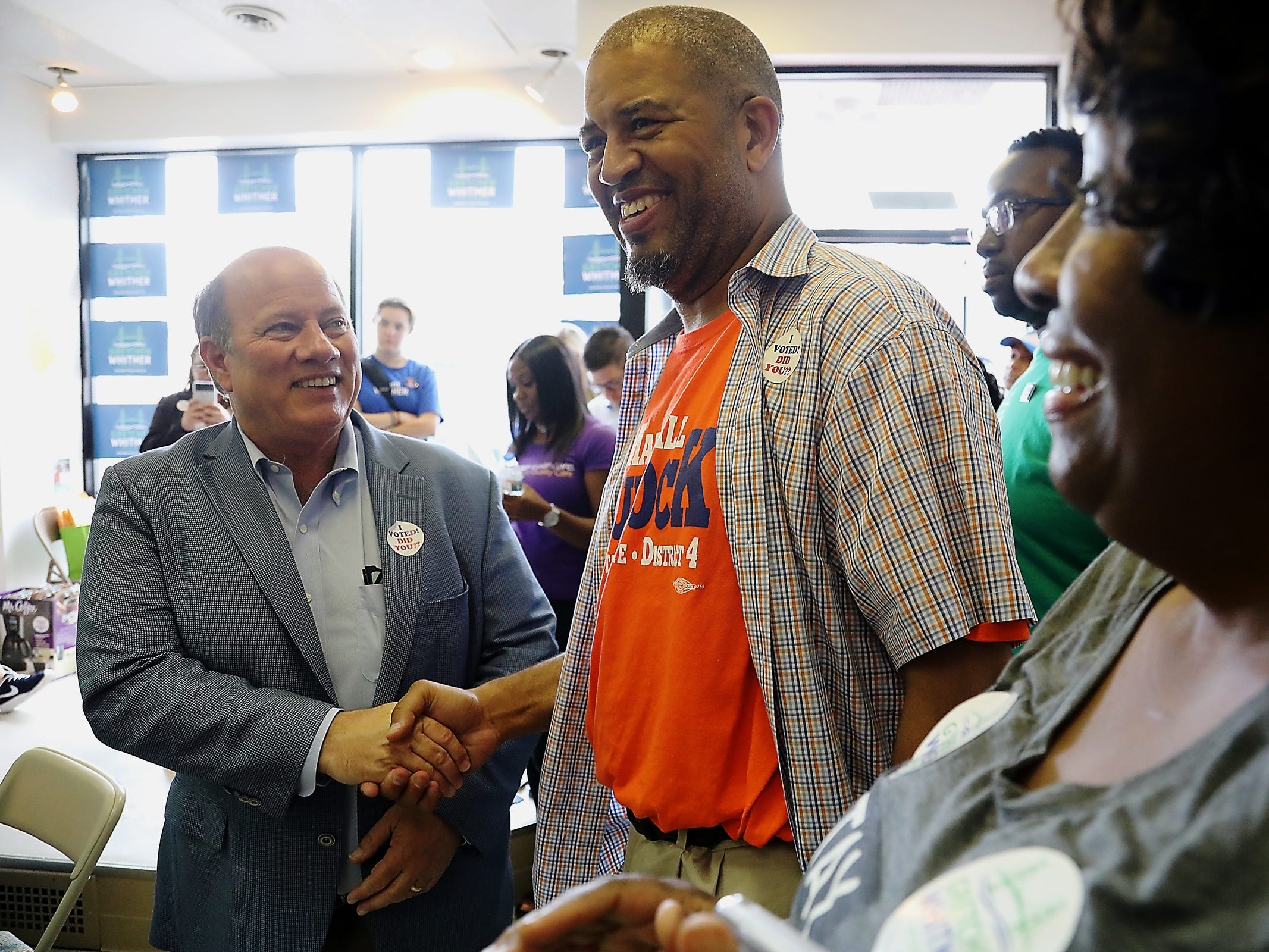 Detroit Mayor Mike Duggan shakes hands with Marshall Bullock, who is running for District 4 State Senate, at Gretchen Whitmer's campaign headquarters on the Livernois Avenue of Fashion in Detroit on Michigan Primary day on Tuesday, Aug. 7, 2018.