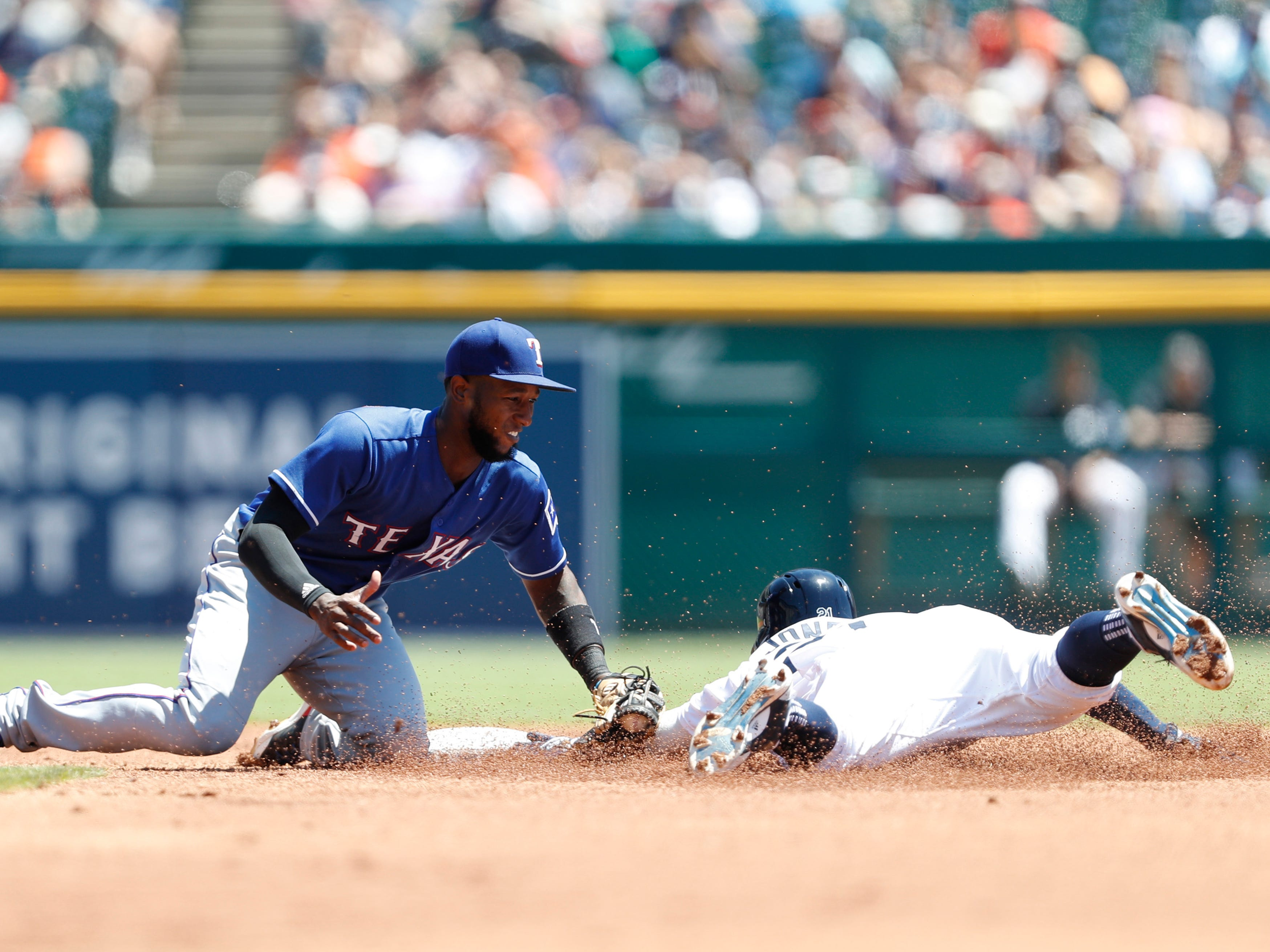 July 8 in Detroit: Rangers 3, Tigers 0. Shortstop Jurickson Profar tags out Tigers center fielder JaCoby Jones at second base during the first inning at Comerica Park.
