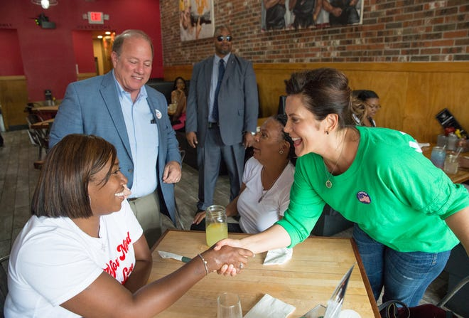 Michigan Democratic gubernatorial candidate Gretchen Whitmer and Detroit Mayor Mike Duggan speak with Kai Bee and Monique David while campaigning in Detroit on Aug. 8, 2018.