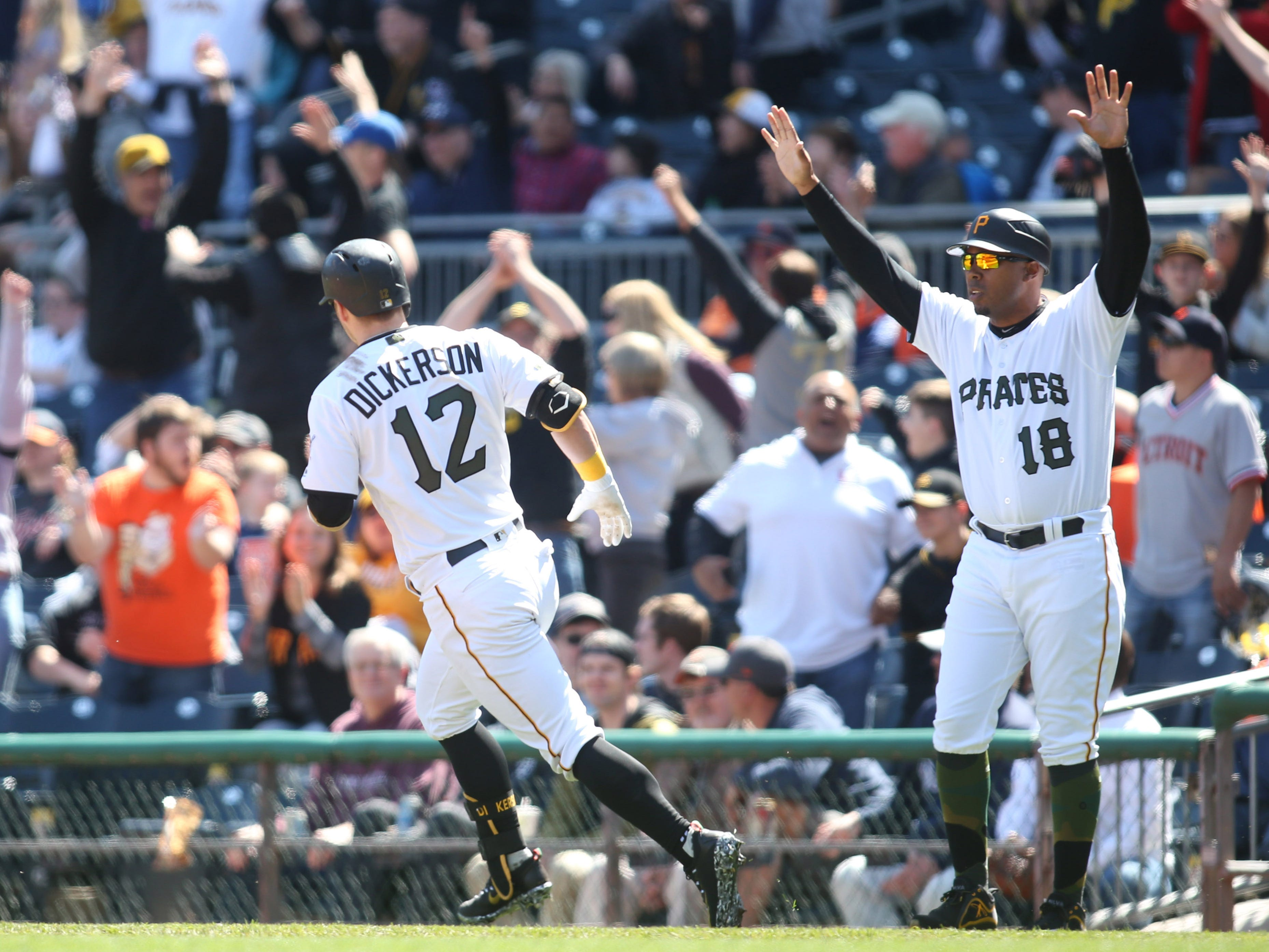 April 26 in Pittsburgh: Pirates 1, Tigers 0. Fans cheer as Corey Dickerson circles the bases on a walk-off home run in the ninth inning at PNC Park.