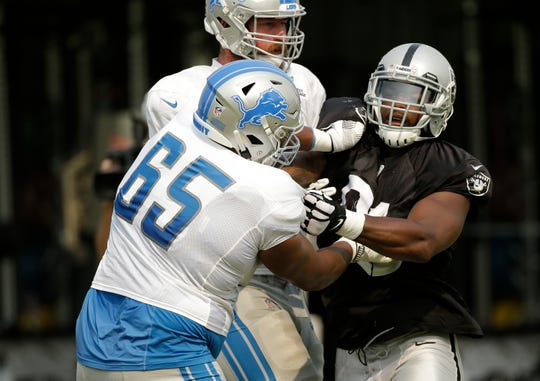 Detroit Lions offensive guard Tyrell Crosby and Oakland Raiders linebacker Shilique Calhoun, right, scrimmage during joint practice with the Raiders, Tuesday, Aug. 7, 2018, in Napa, Calif.