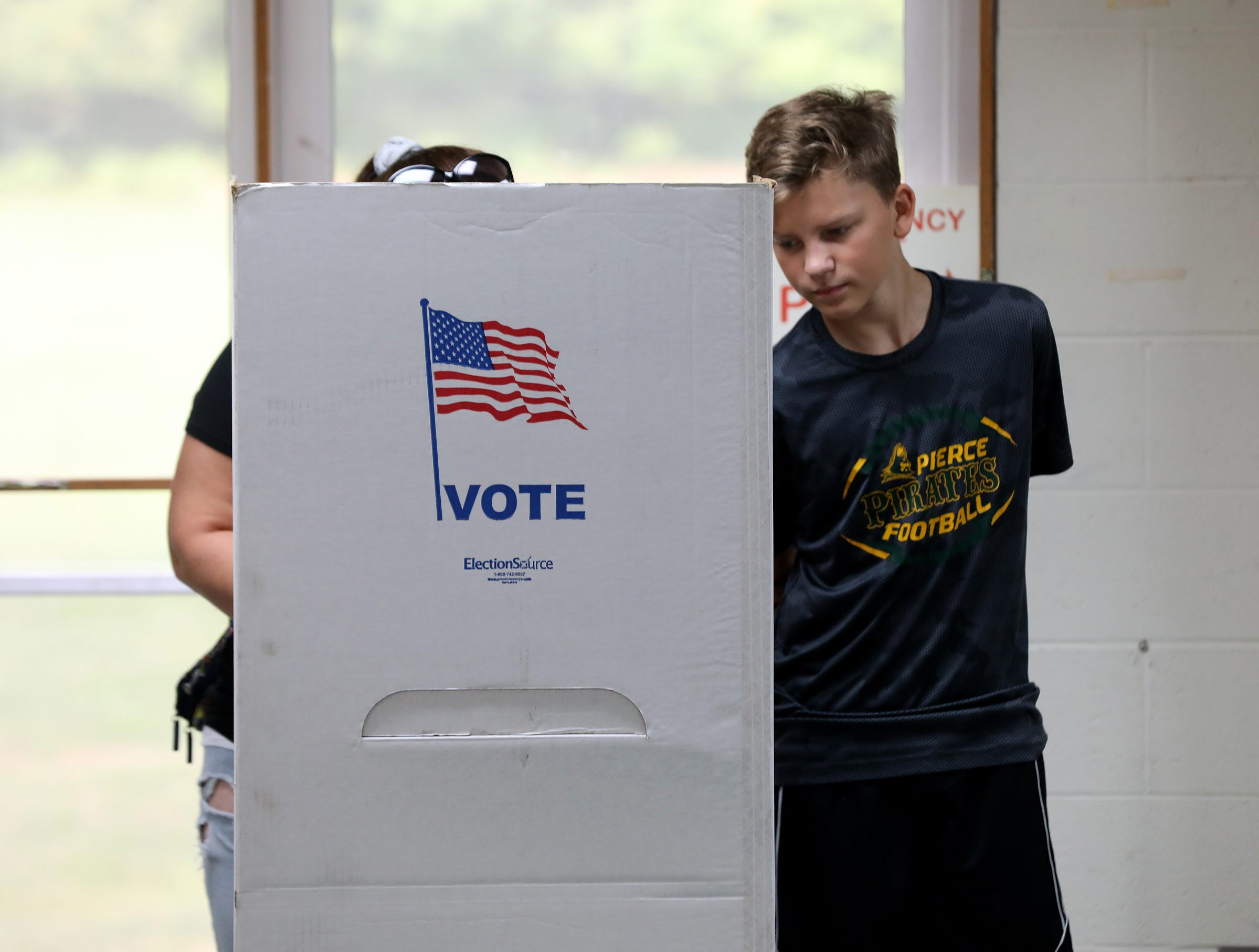 Tamara McManus, 27 of Waterford wanted to bring her son Luke Dusseau, 13, right, of Waterford into Precinct 11 in Waterford on Tuesday, August 7, 2018 to learn and understand the election process.