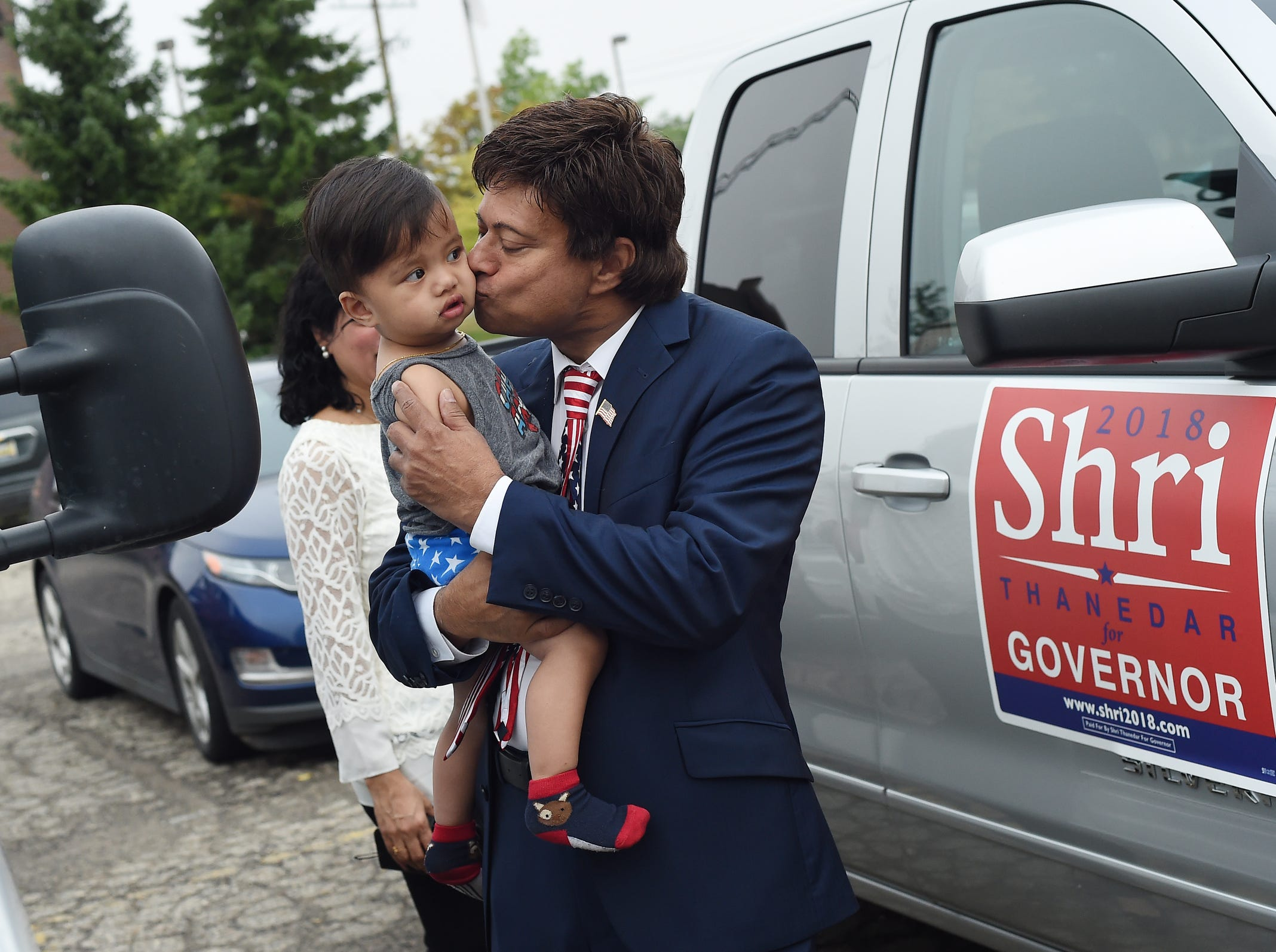 Democratic gubernatorial candidate Shri Thanedar kisses his 18-month-old grandson Kai Thanedar, of San Fransisco, while in the parking lot after casting his ballot in the Michigan primary election at the Pittsfield Community Center in Pittsfield Township on Tuesday, August 7, 2018.