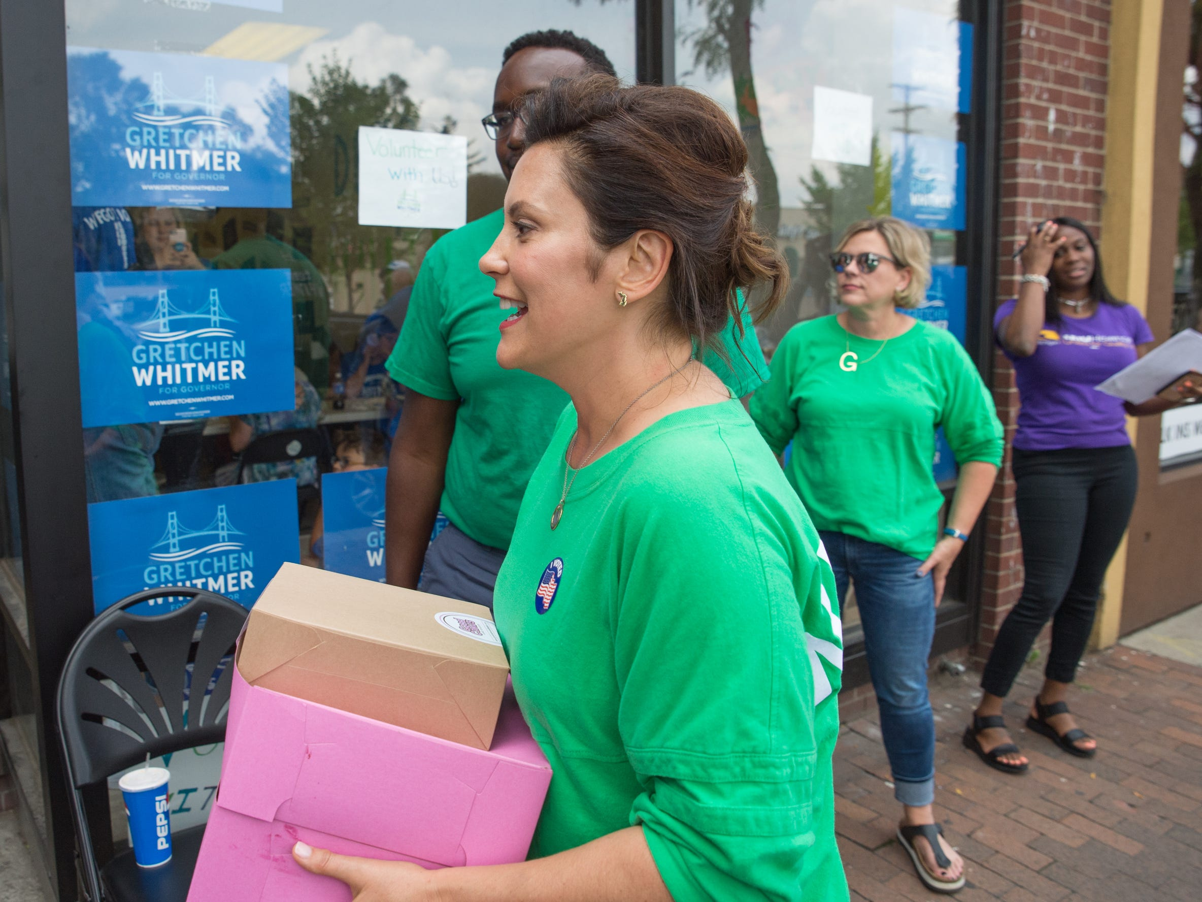 Michigan Democratic gubernatorial candidate Gretchen Whitmer greets volunteers at her field office on Livernois Avenue in Detroit on Aug. 8, 2018.