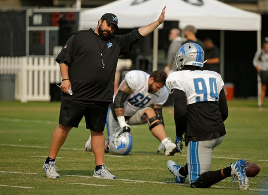 Detroit Lions head coach Matt Patricia gestures while talking with defensive end Ziggy Ansah during practice a joint practice with the Raiders, Tuesday, Aug. 7, in Napa, Calif.