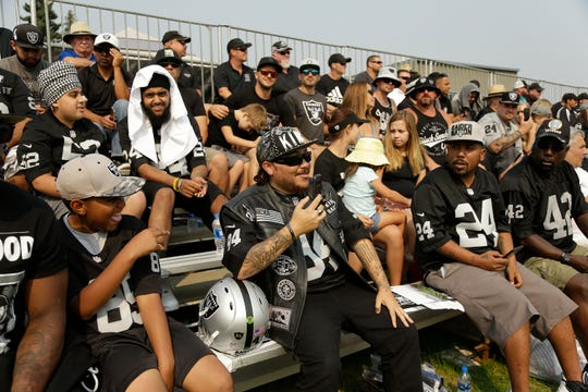 Oakland Raiders fans watch an NFL practice with the Detroit Lions, Tuesday, Aug. 7, 2018, in Napa, Calif.