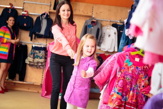 Mother And Daughter At Children S Store