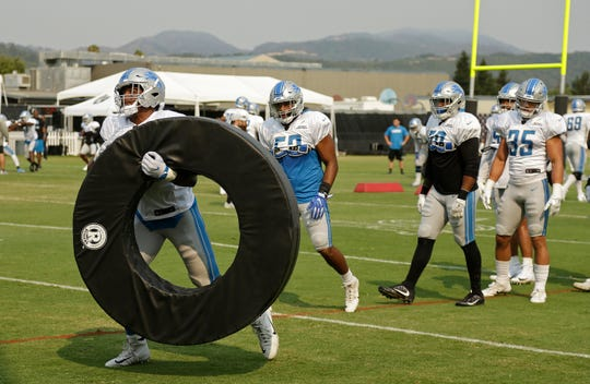 Detroit Lions linebacker Devon Kennard carries a ring during joint practice with the Raiders, Tuesday, Aug. 7, 2018, in Napa, Calif.