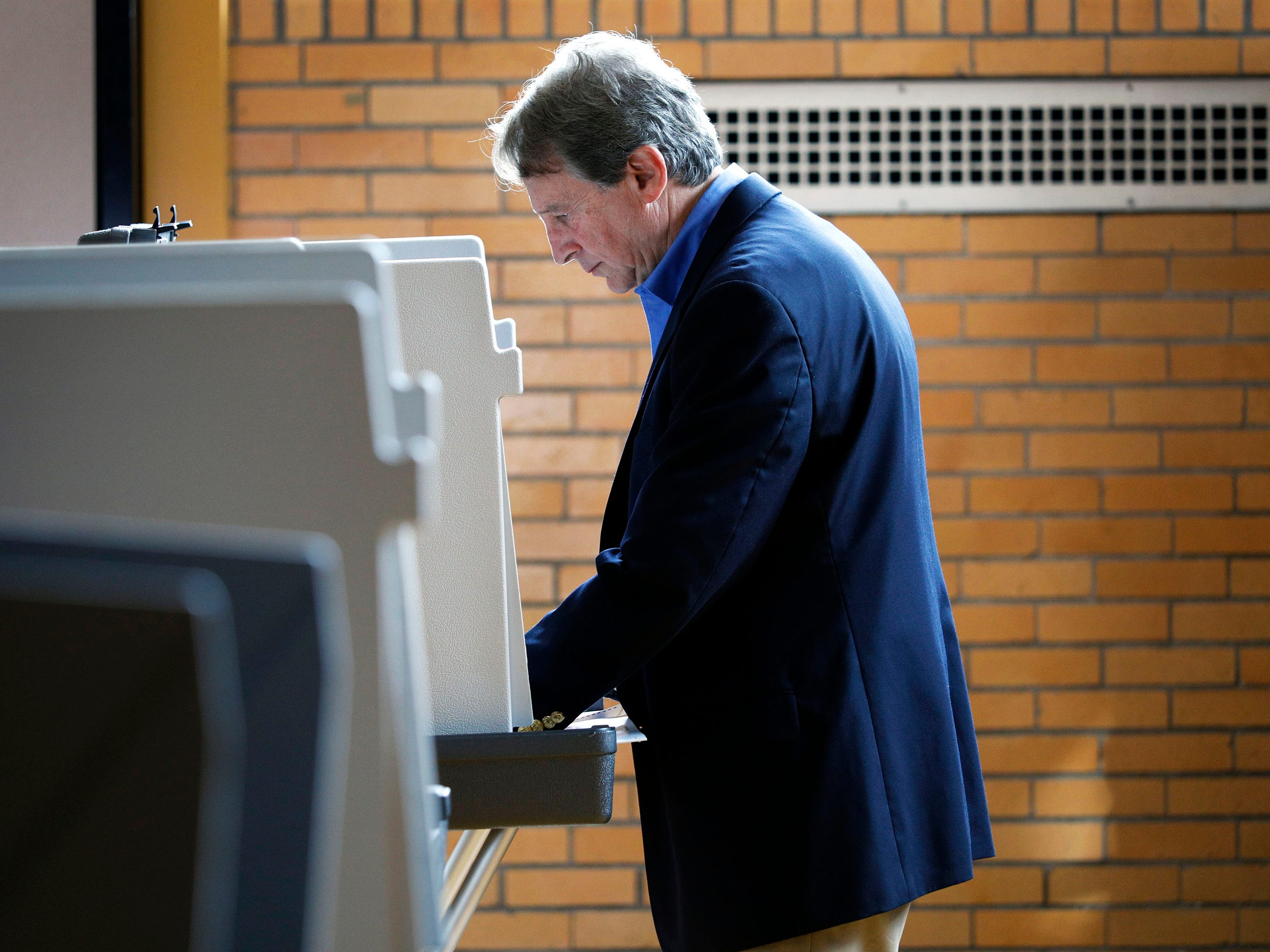 Sandy Pensler, Michigan Republican candidate for the U.S. Senate, casts his vote in the Michigan Primary election at Trombly School August 7, 2018 in Grosse Pointe Park, Michigan. Pensler's opponent, Republican John James, has received President Donald Trump's endorsement.