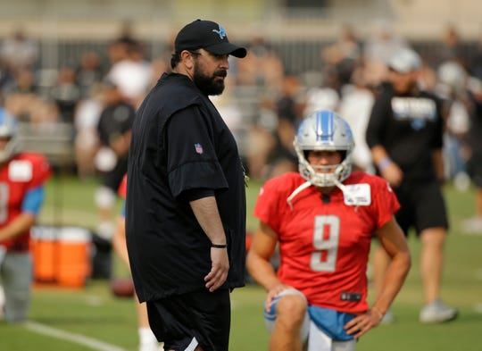 Detroit Lions head coach Matt Patricia watches players stretch as quarterback Matthew Stafford looks on during a joint practice with the Raiders, Tuesday, Aug. 7, in Napa, Calif.