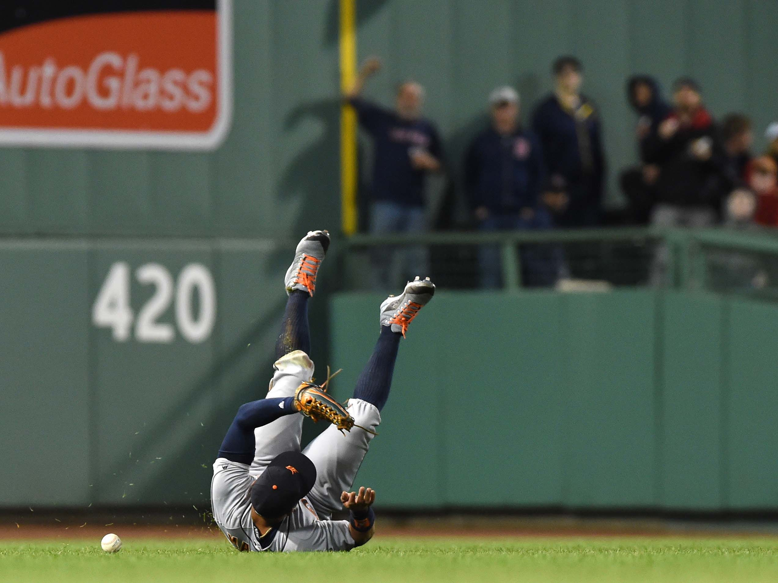June 5 in Boston: Red Sox 6, Tigers 0. Center fielder Leonys Martin misplays the ball during the fifth inning at Fenway Park.
