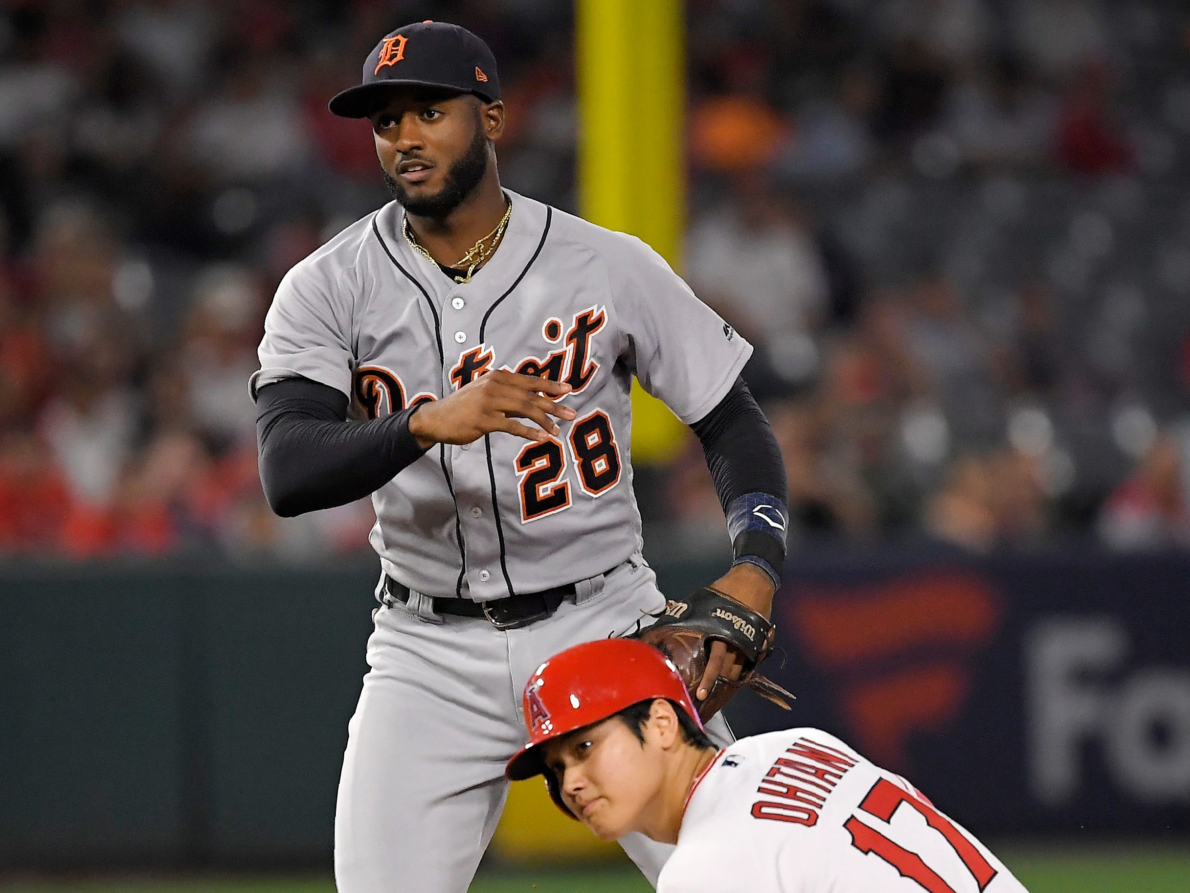 Angels designated hitter Shohei Ohtani is forced out at second as Tigers second baseman Niko Goodrum throws out Andrelton Simmons at first during the sixth inning on Monday, Aug. 6, 2018, in Anaheim, Calif.
