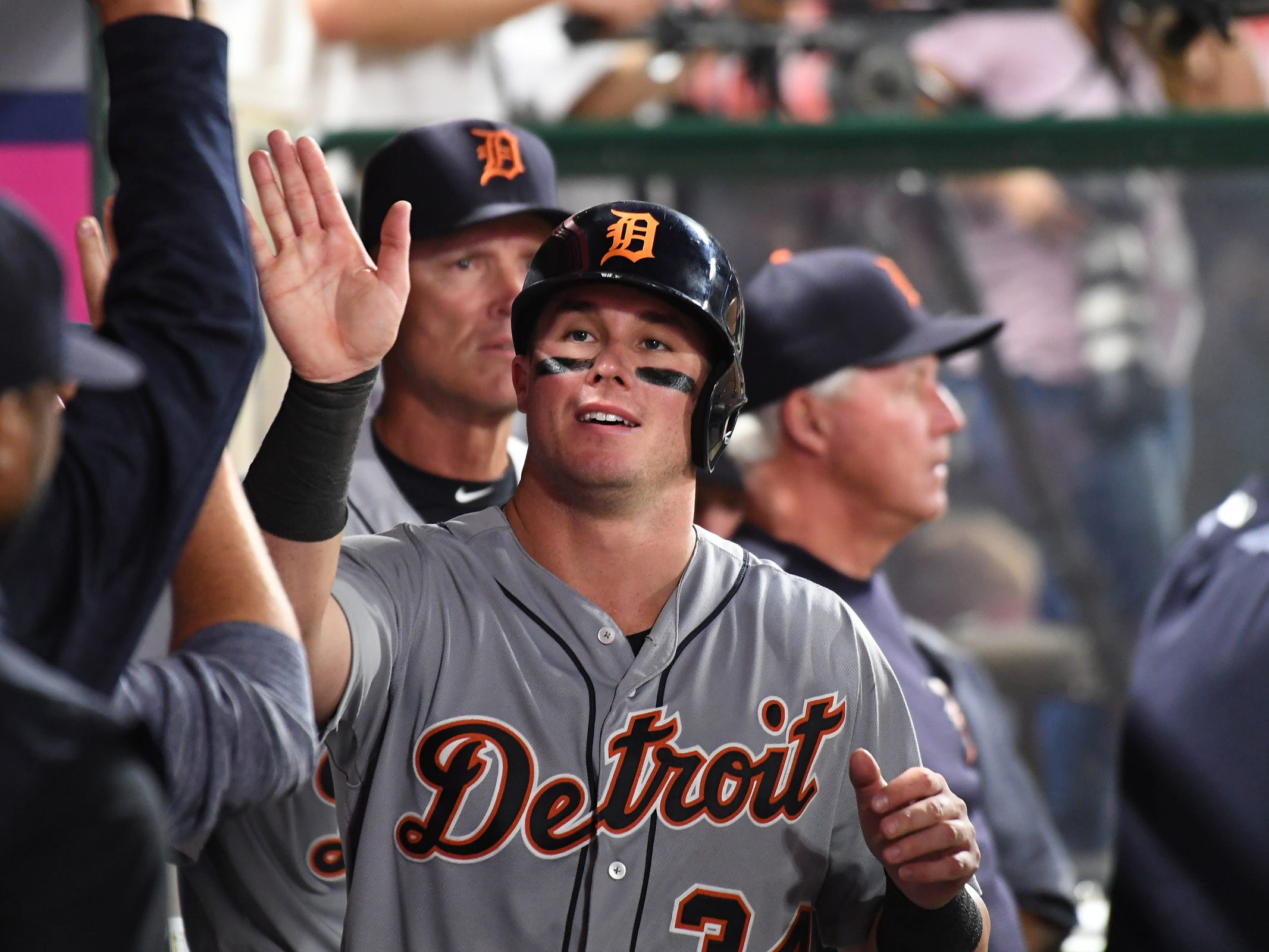 Tigers catcher James McCann celebrates with teammates after scoring a run off a hit by Tigers shortstop Jose Iglesias (not pictured) during the sixth inning on Monday, Aug. 6, 2018, in Anaheim, Calif.