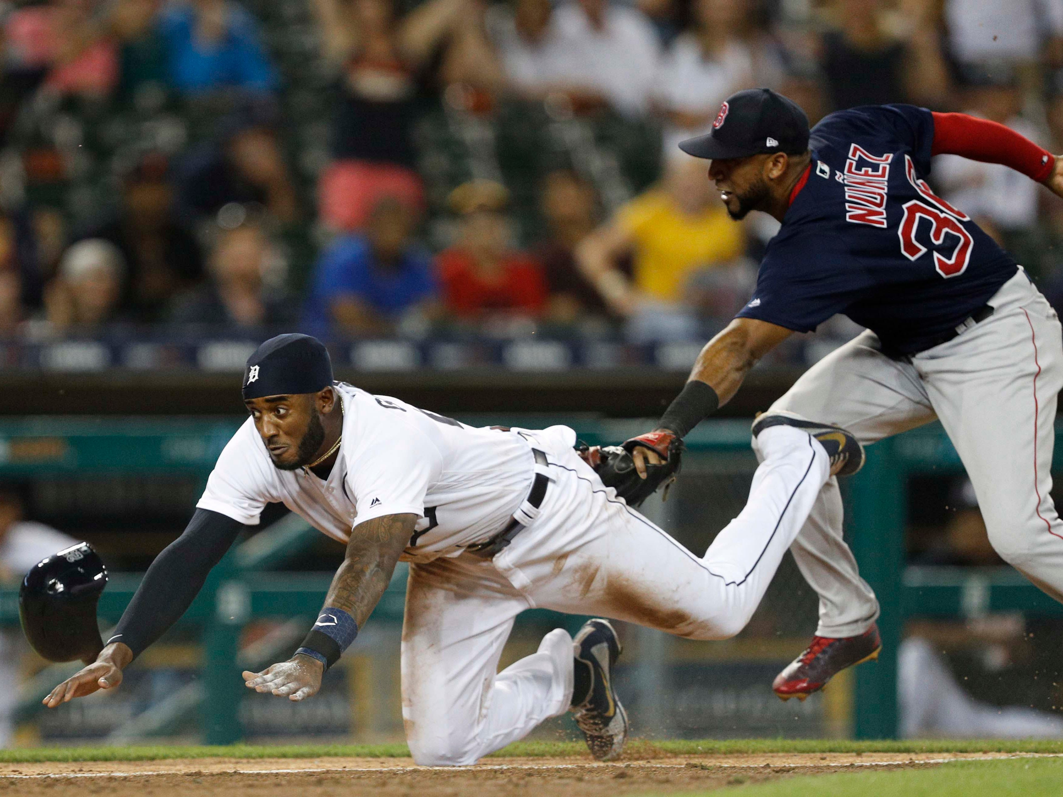 July 20 in Detroit: Red Sox 1, Tigers 0. Second baseman Eduardo Nunez tags out Niko Goodrum at home during the eighth inning at Comerica Park.