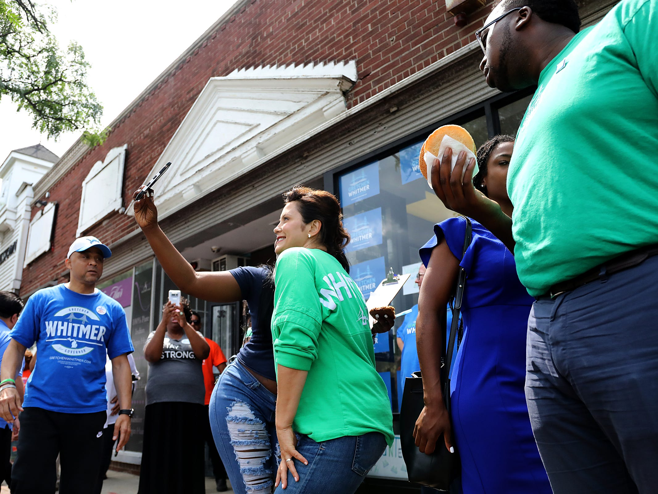 Gubernatorial Democratic Candidate Gretchen Whitmer takes photos with supporters outside her campaign headquarters on Livernois Avenue of Fashion on Michigan Primary day on Tuesday, Aug. 7, 2018.