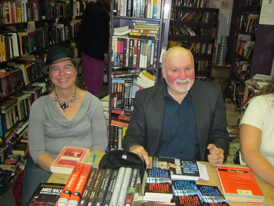 Michigan authors Sarah Zettel, left, and Loren D. Estleman at an Aunt Agatha's book signing in 2012.