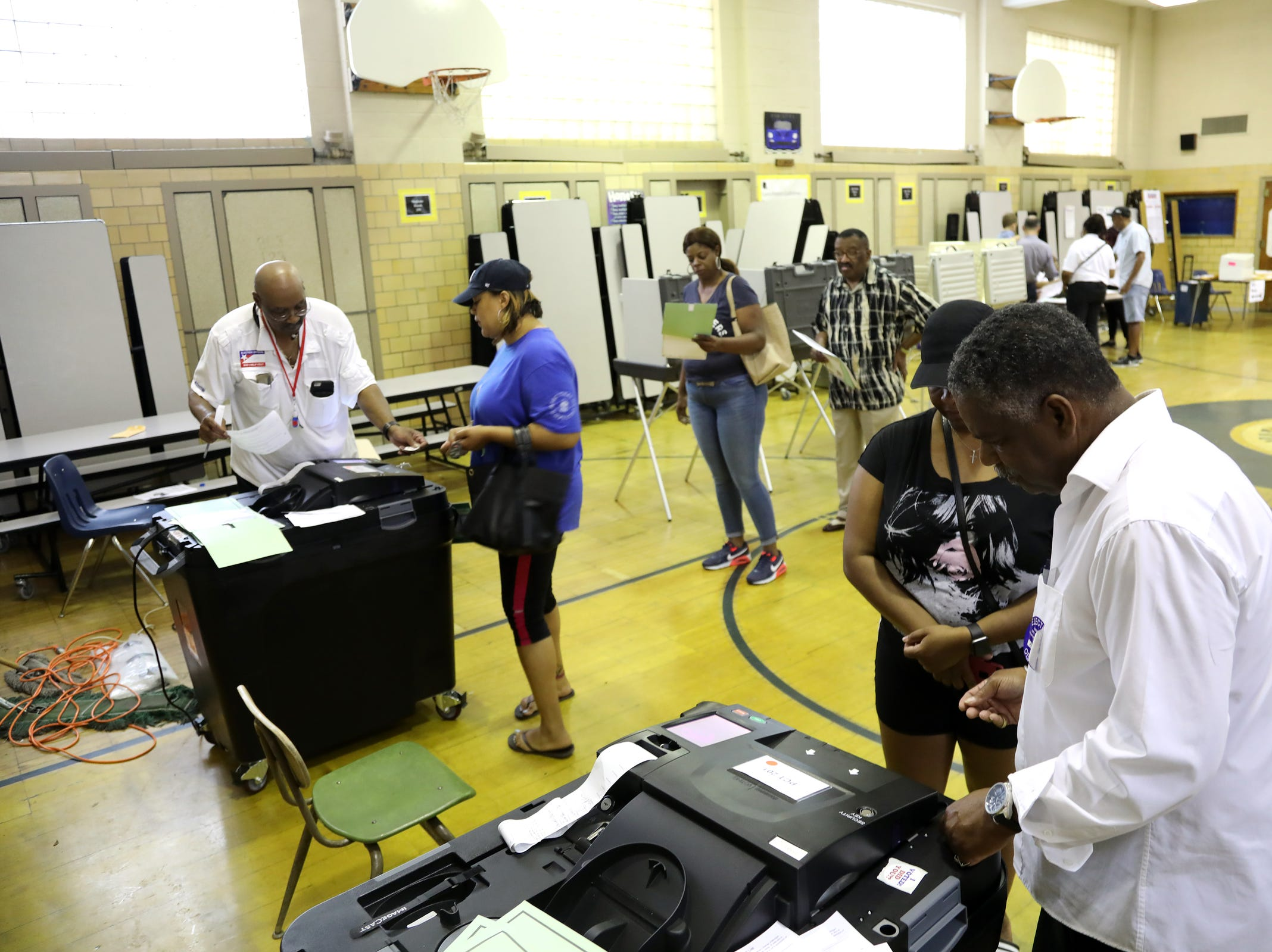 Detroit voters wait to cast their ballots in the Michigan primaries at Pasteur Elementary in Detroit on Tuesday, Aug. 7, 2018.