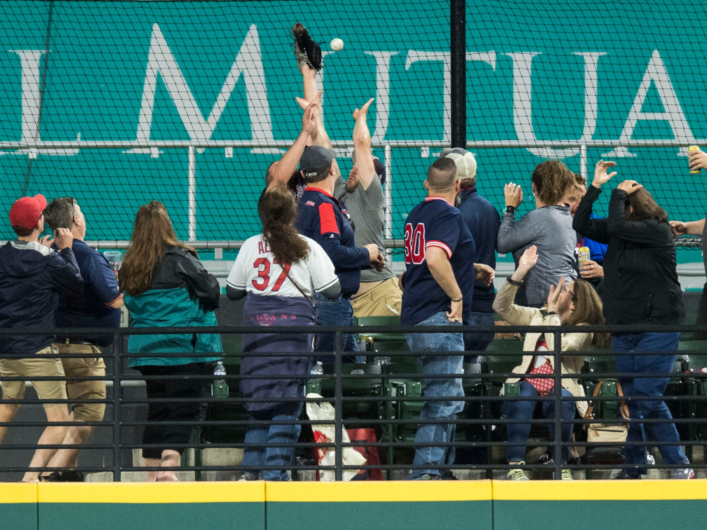 June 22 in Cleveland: Indians 10, Tigers 0. Center fielder Leonys Martin watches as fans try to catch a grand slam hit by Indians first baseman Yonder Alonso in the seventh inning at Progressive Field.