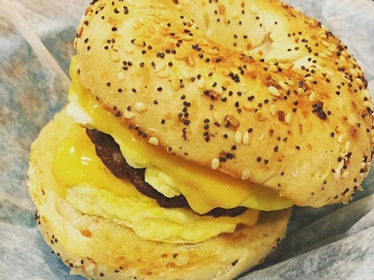 A breakfast sandwich made with an everything bagel and sausage at Falling Rock Cafe and Bookstore in Munising.