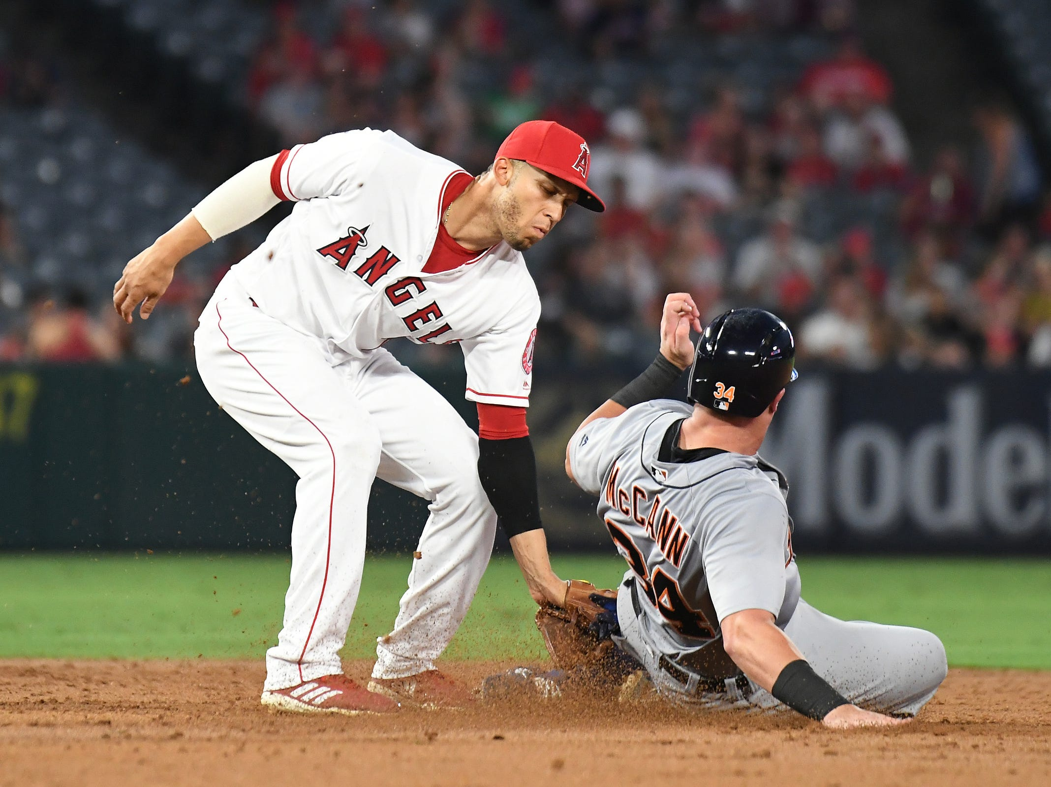 Tigers catcher James McCann attempts to steal as Angels shortstop Andrelton Simmons applies a tag during the third inning on Monday, Aug. 6, 2018, in Anaheim, Calif.