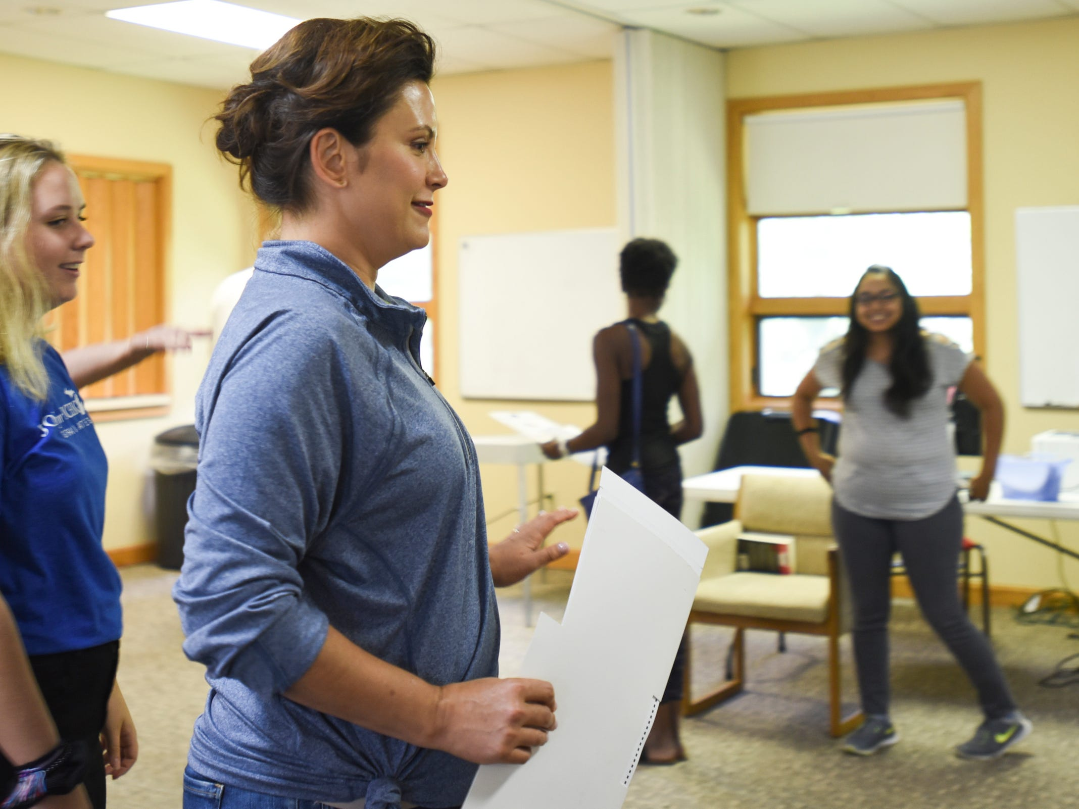 Michigan Democratic gubernatorial candidate Gretchen Whitmer gets ready to cast her ballot Tuesday at St. Paul Lutheran church in East Lansing, Mich.