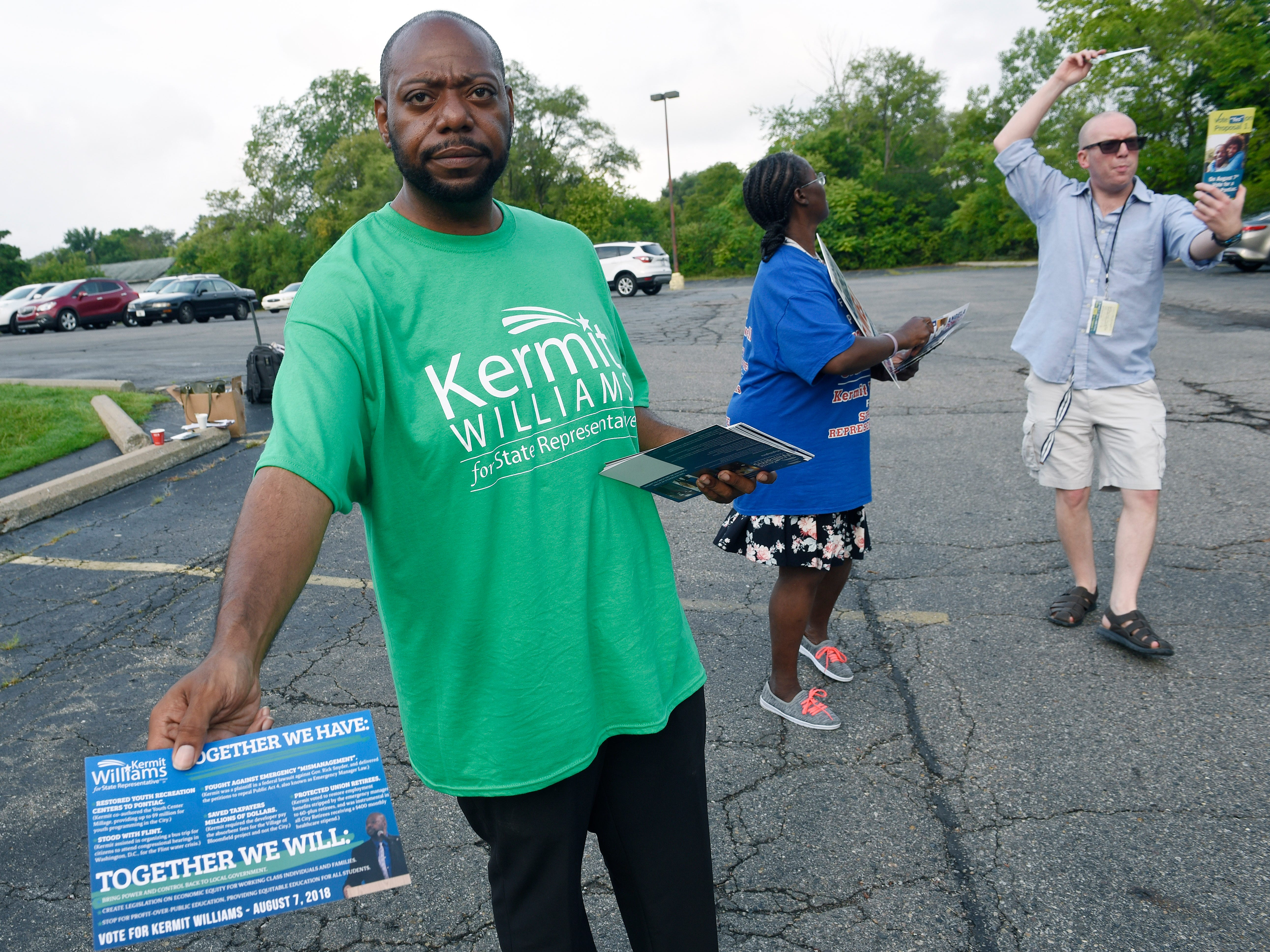 Kermit Williams ,who is running for state representative, hands out literature about his campaign Tuesday morning at New Bethel Missionary Baptist church.*** Voters and campaign workers at New Bethel Missionary Baptist church. August 7, 2018, Pontiac, MI. (ClarenceTabb Jr./Detroit News)