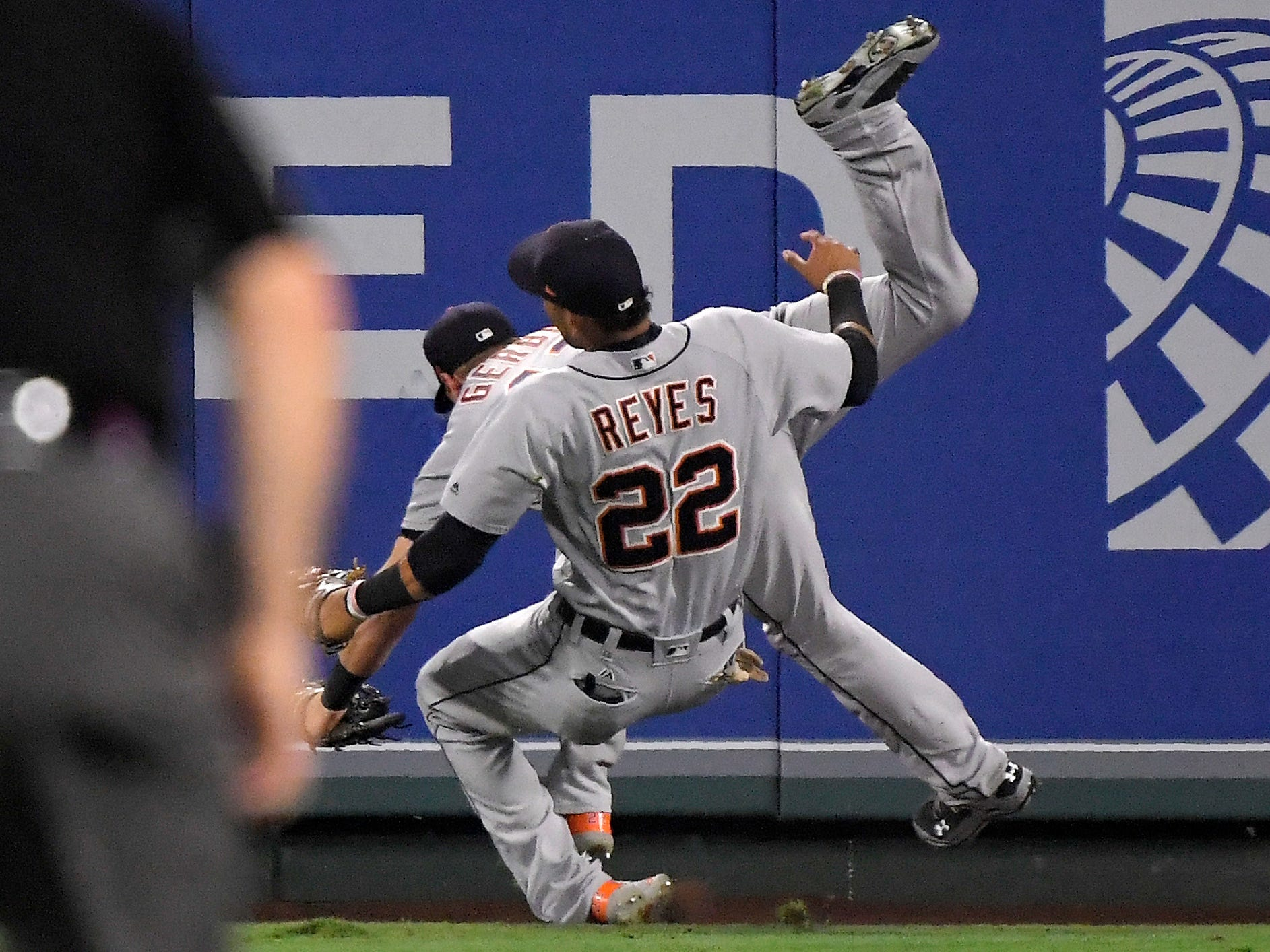 Detroit Tigers center fielder Mike Gerber, left, collides with left fielder Victor Reyes after making a catch on a ball hit by Los Angeles Angels' Kole Calhoun during the third inning.