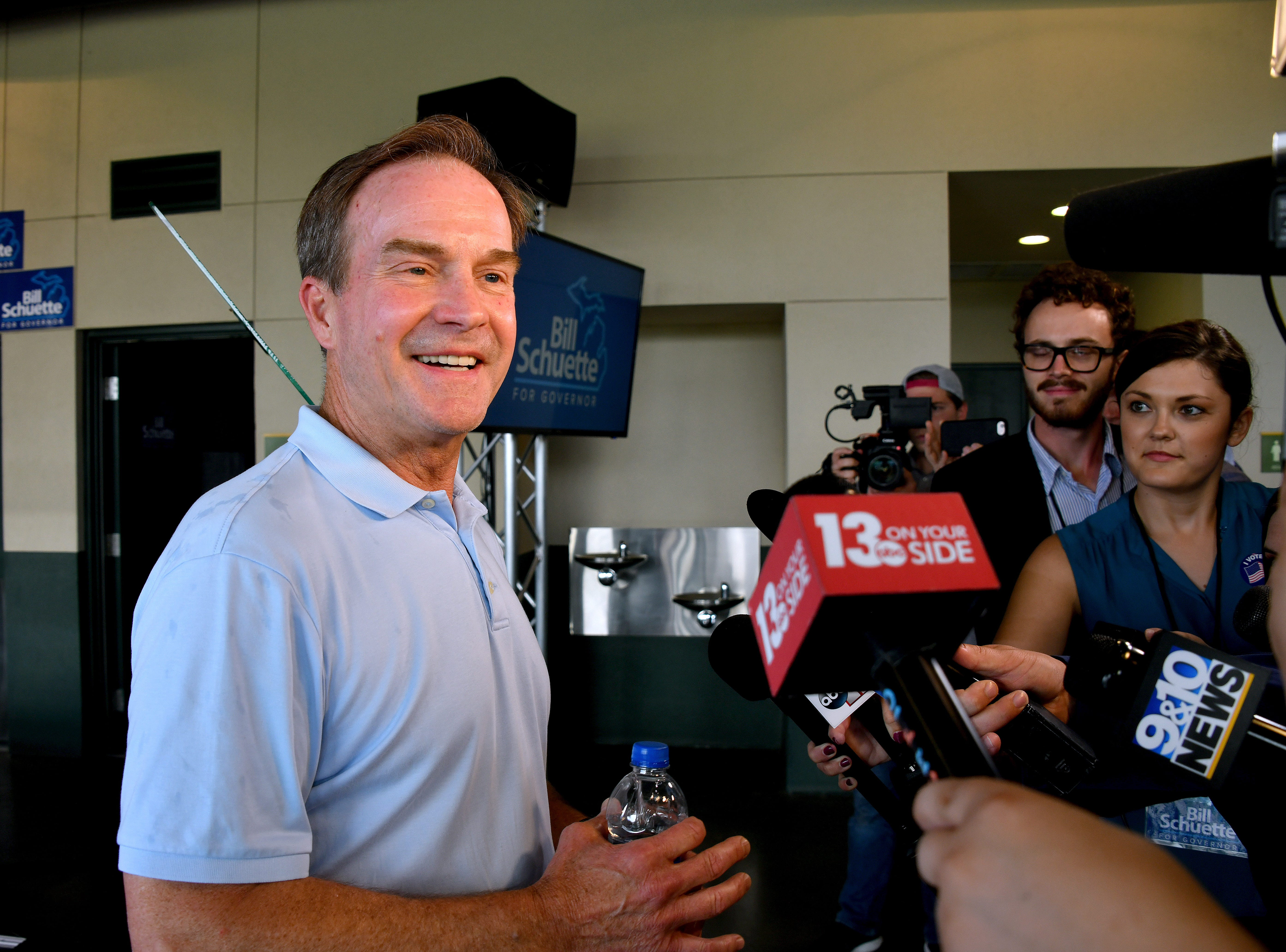Michigan Attorney General Bill Schuette faces the media scrum just hours before the polls close on primary election day, Aug 7, 2018.  Schuette's post-election event is being held at Dow Diamond, the home of Midland's minor league baseball team.