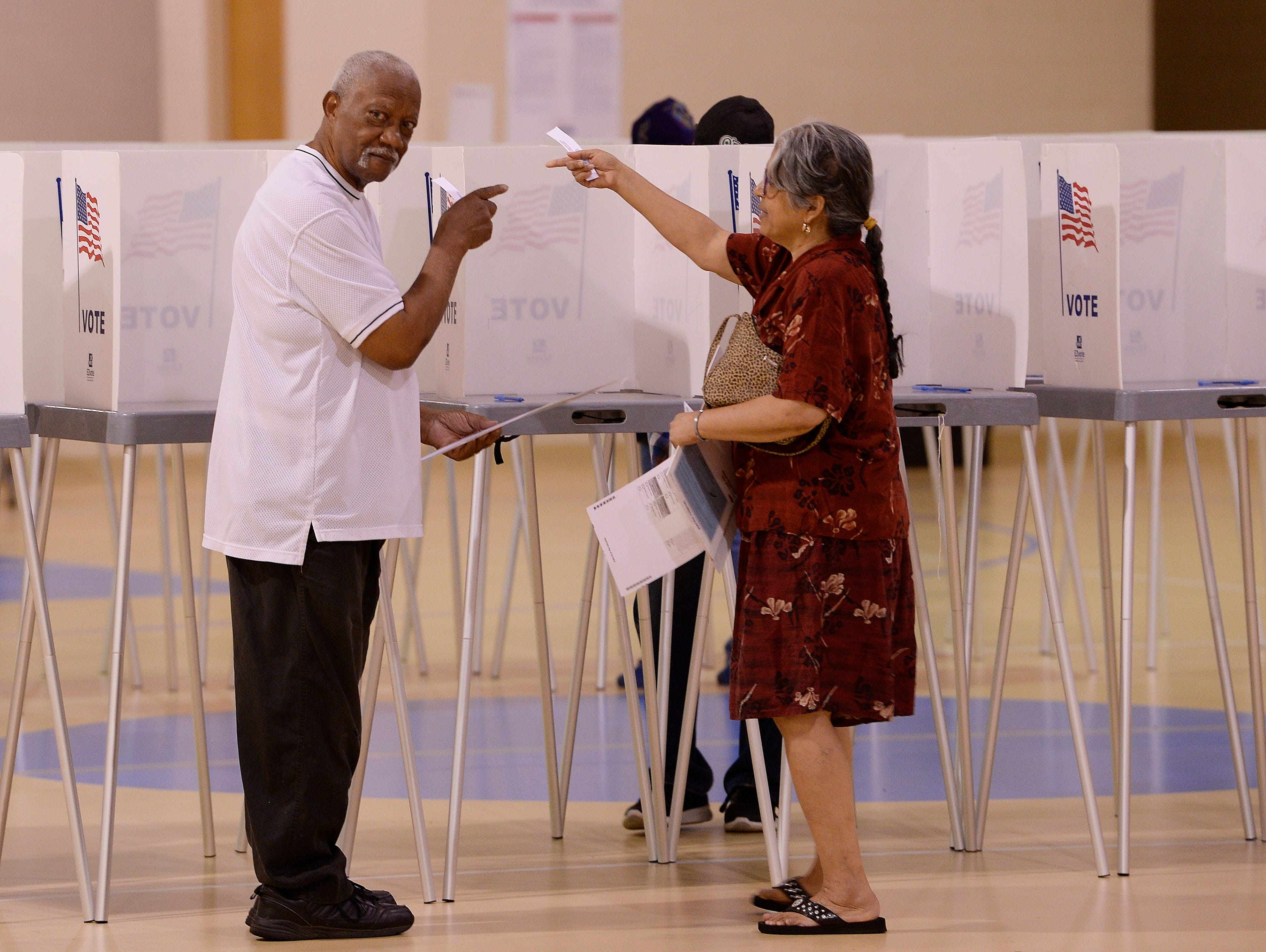 Melvin Taylor, 83, and his wife Marcia Taylor of Pontiac talk after casting their votes Tuesday morning at New Bethel Missionary church in Pontiac.