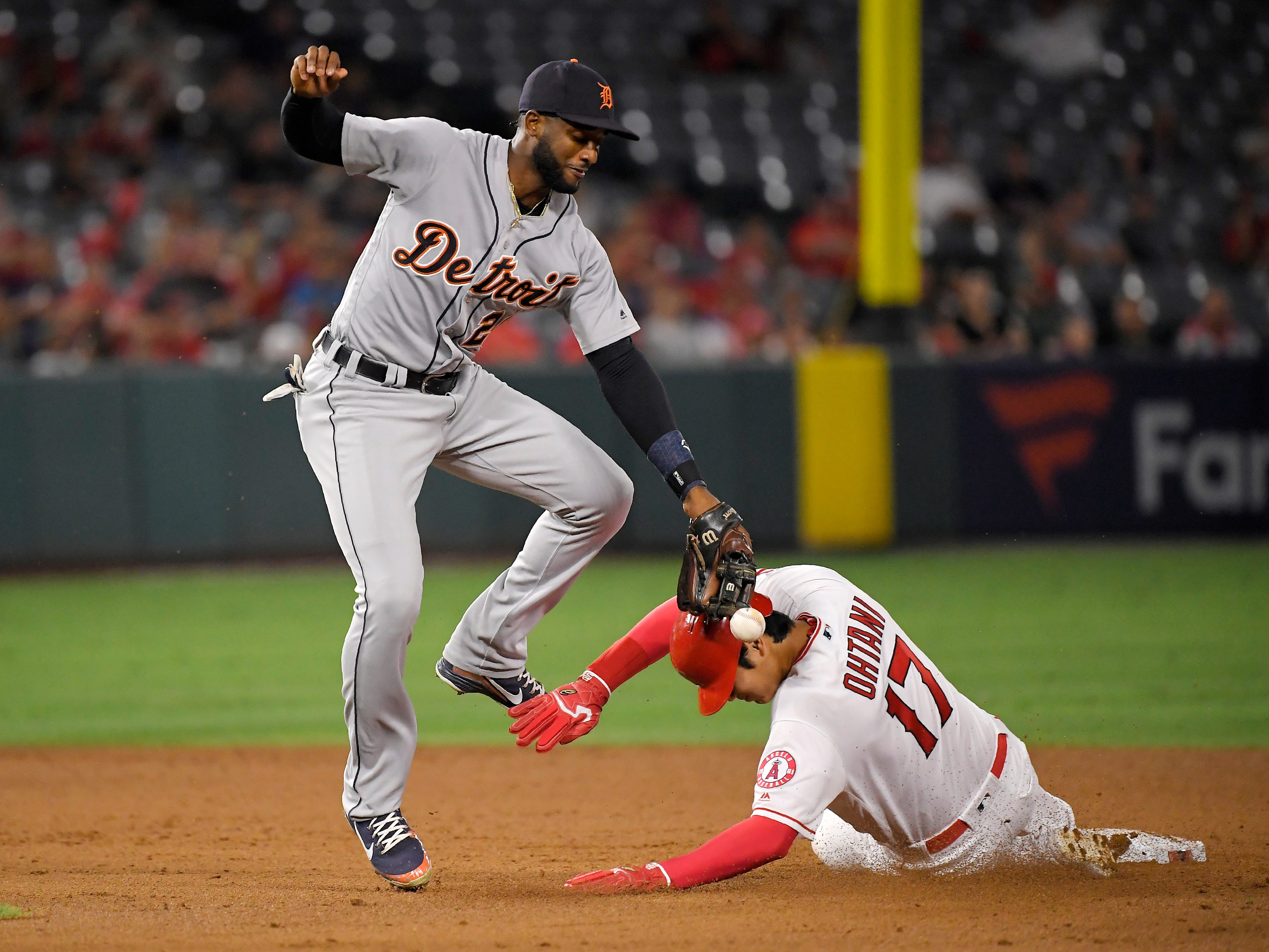 Los Angeles Angels' Shohei Ohtani, right, of Japan, knocks the ball from the glove of Detroit Tigers second baseman Niko Goodrum as he steals second during the eighth inning.