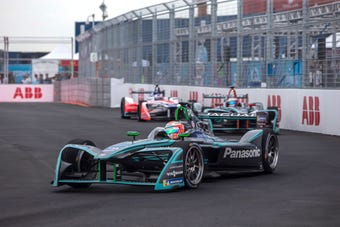 Quiet riot: With only the whine of electric motors, Formula E racers negotiate the Brooklyn street course.