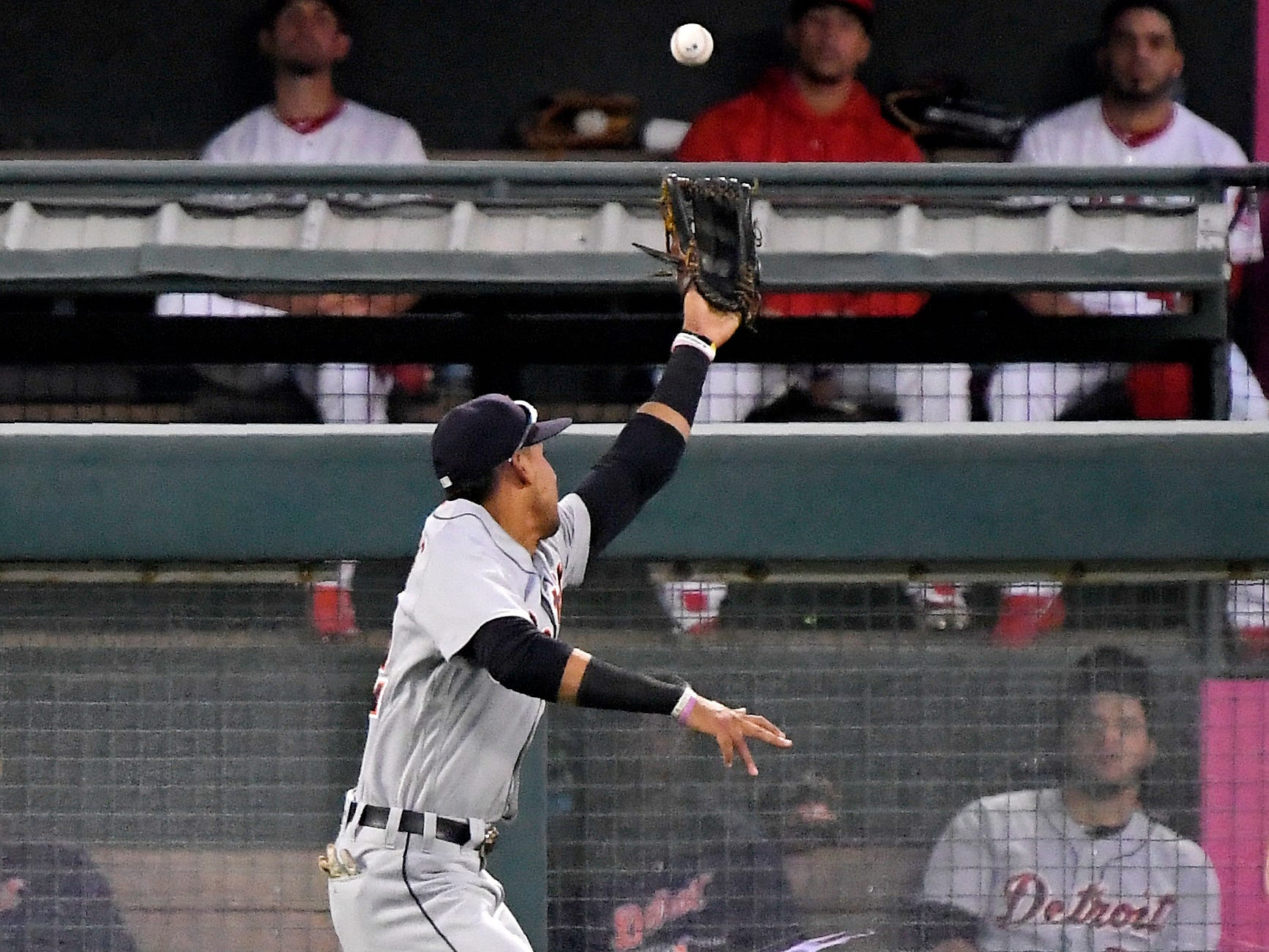Detroit Tigers left fielder Victor Reyes can't reach a ball hit for an RBI double by Los Angeles Angels' Kaleb Cowart during the second inning.