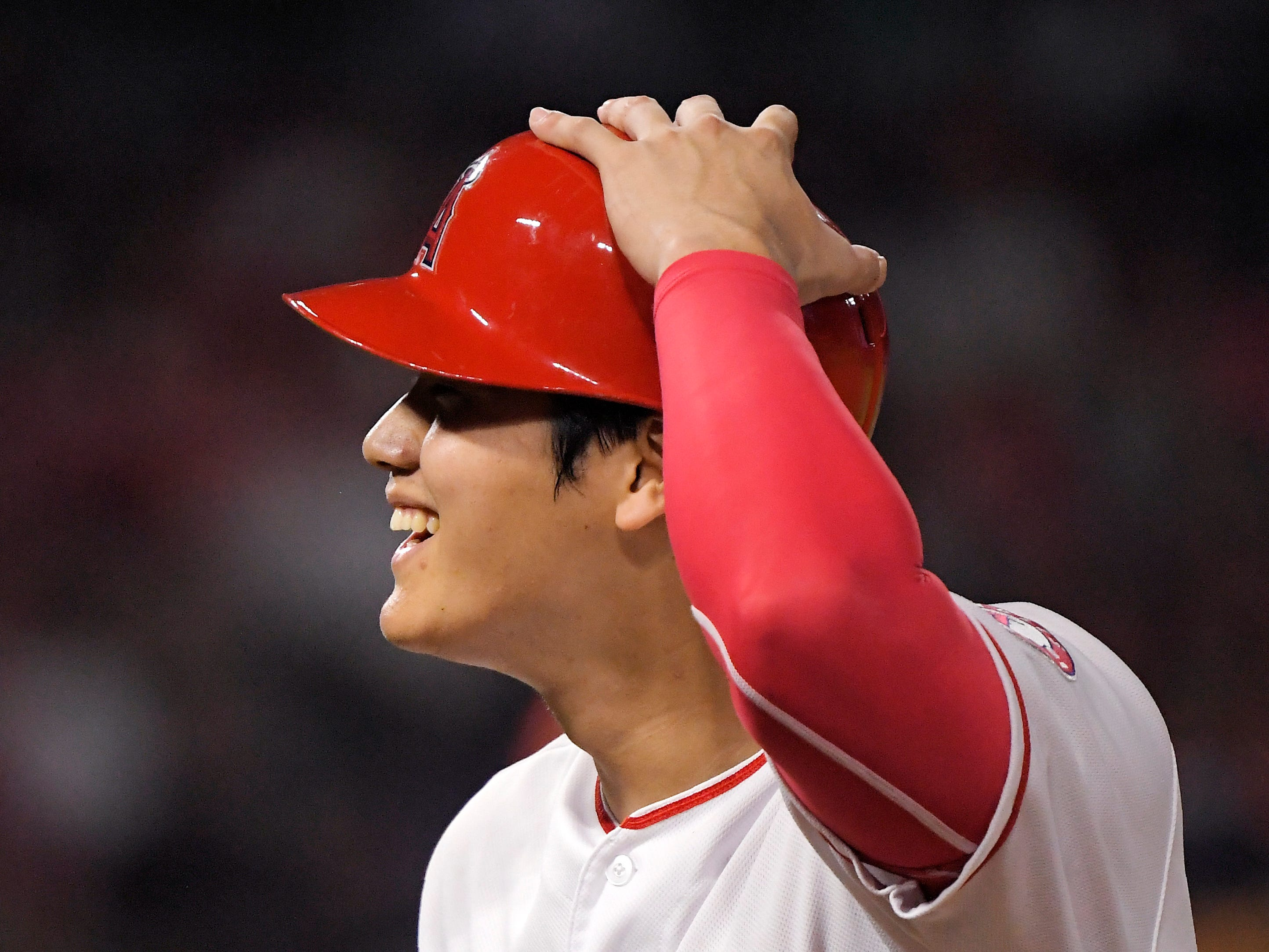 Los Angeles Angels' Shohei Ohtani, of Japan, smiles after being intentionally walked during the sixth inning.