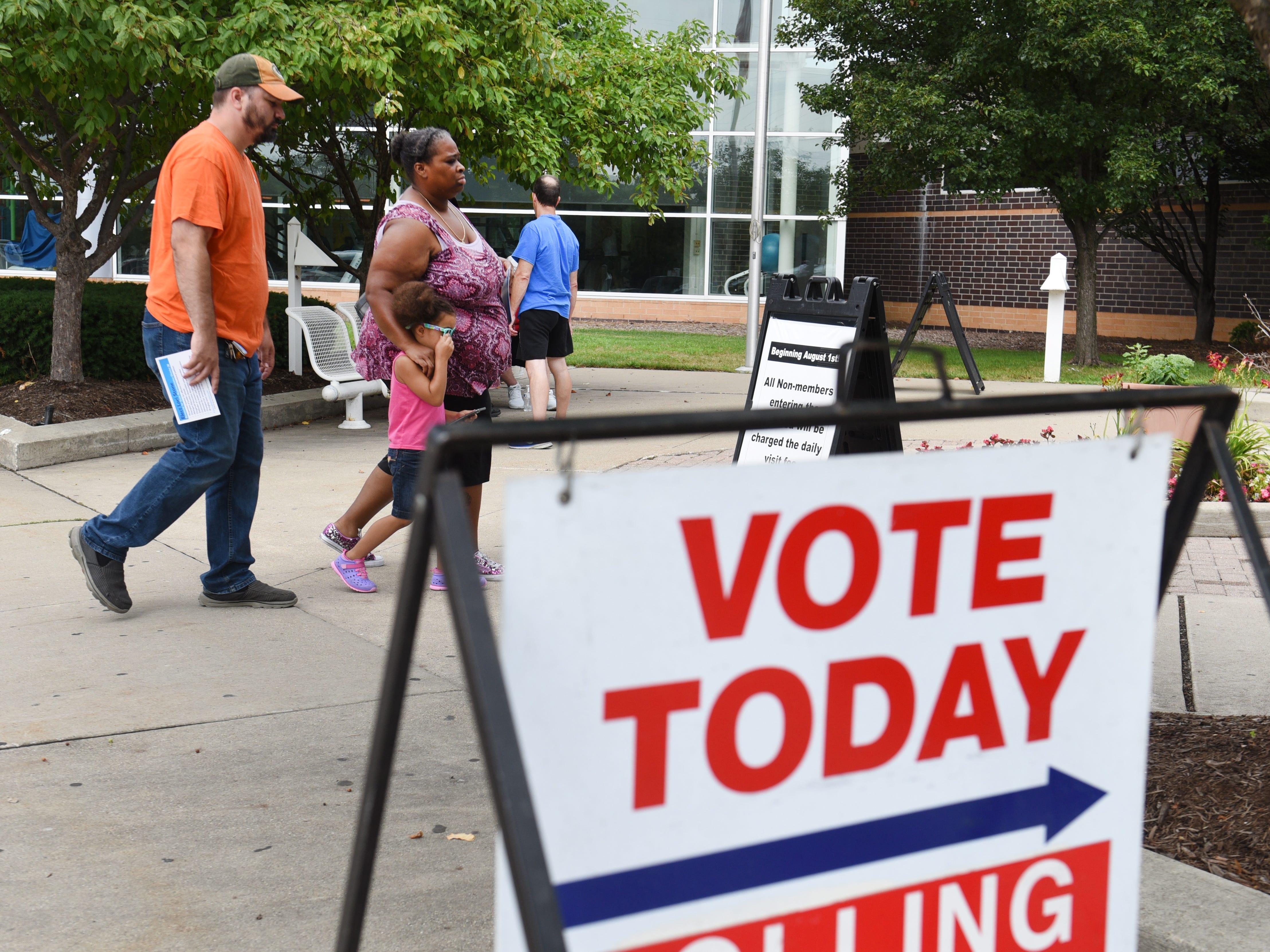 People enter the voting precinct on Tuesday outside Warren Community Center in Warren.