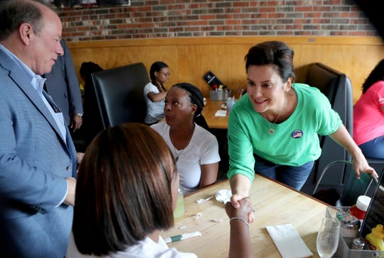 Michigan Democratic gubernatorial candidate Gretchen Whitmer and Detroit Mayor Mike Duggan visit with patrons at a restaurant on Detroit's north side, Tuesday.
