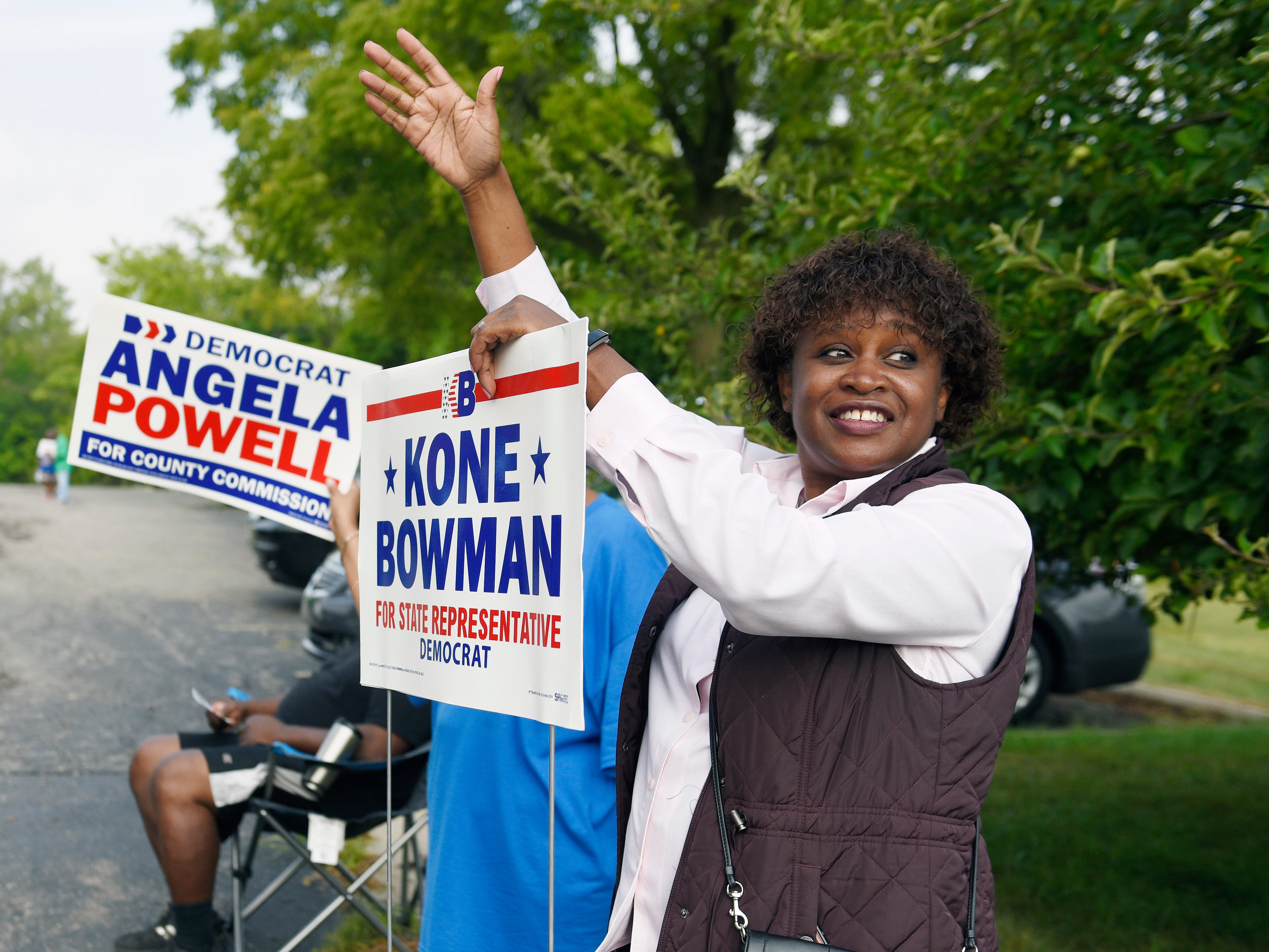 Weata Powell, volunteer worker for Kone Bowman, waves to voters as they arrive to cast their votes at New Bethel Missionary Baptist church this morning.**Voters and campaign workers at New Bethel Missionary Baptist church. August 7, 2018, Pontiac, MI. (ClarenceTabb Jr./Detroit News)