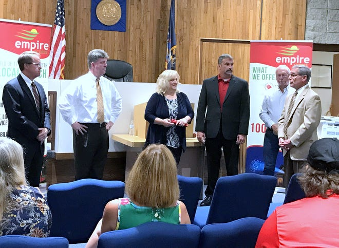 Elmira Heights and Chemung County officials join representatives from Empire Access on Tuesday to celebrate new internet service in the village.
