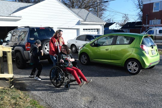 Wade Conway and Kendra Creek, along with Kendra's caregiver, Sara Overby, head for the realtors office to sign papers for their first apartment together in December of last year.