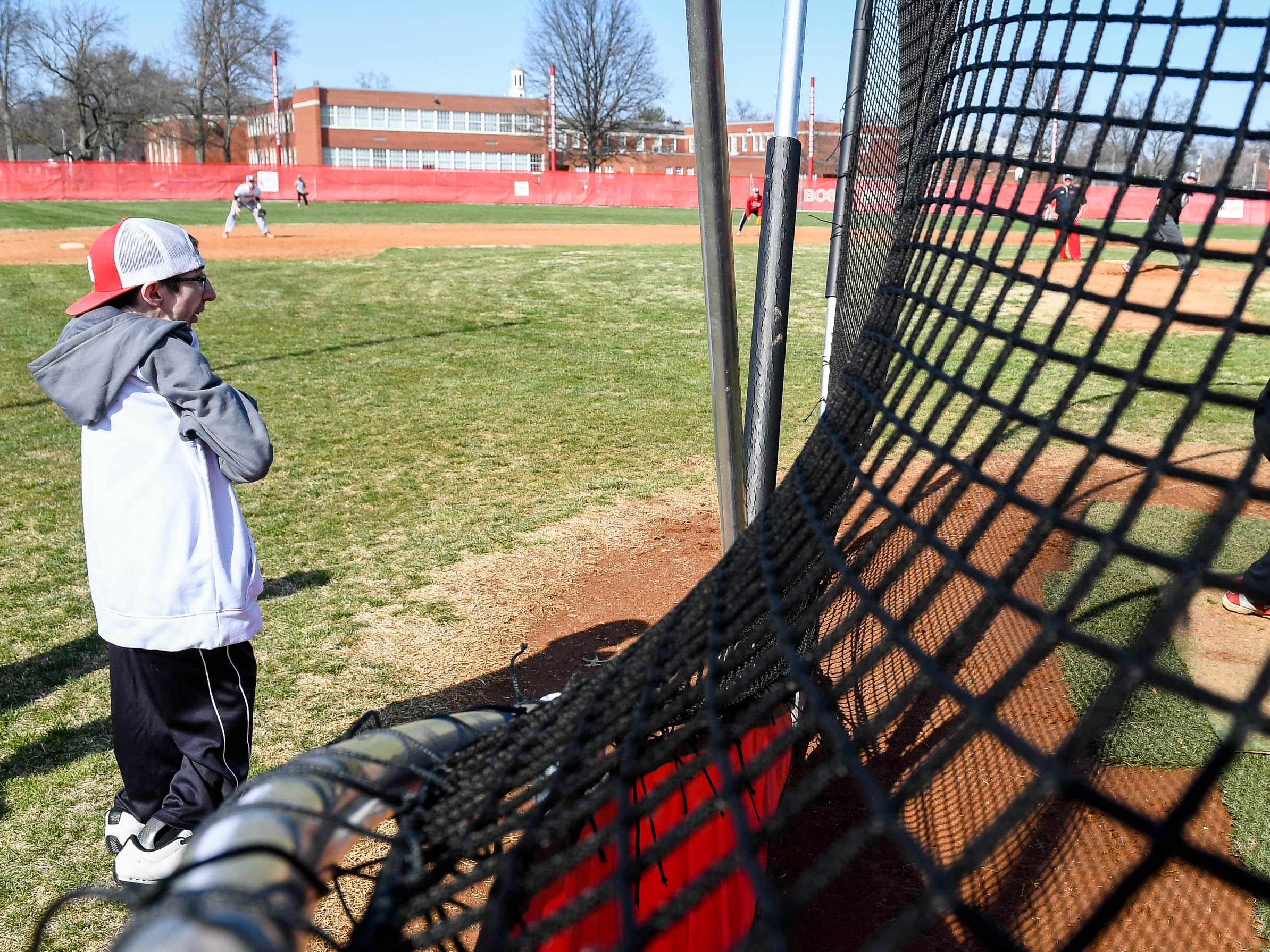 Wade Conway, one of the assistant coaches for the Bosse High School baseball team, watches batting practice in March of 2018.