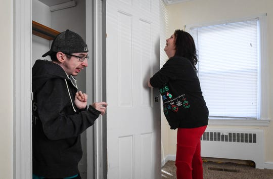 Kendra Creek pretends to lock Wade Conway in the closet as the pair explore their first apartment together.
