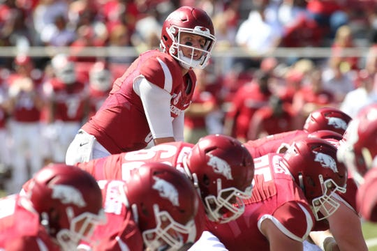 Sep 30, 2017; Fayetteville, AR, USA; Arkansas Razorbacks quarterback Austin Allen (8) at the line in the second half against the New Mexico State Aggies at Donald W. Reynolds Razorback Stadium. Arkansas won 42-24. Mandatory Credit: Nelson Chenault-USA TODAY Sports