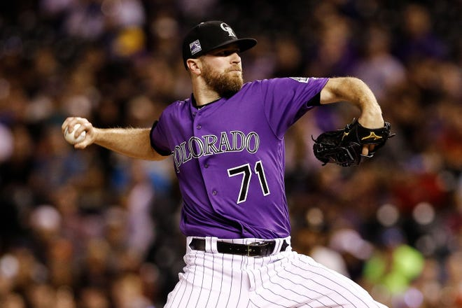 Reliever Wade Davis, shown pitching in the ninth inning of a win Monday over the Pirates, and the Colorado Rockies close out a three-game series against Pittsburgh with a 1:10 p.m. home game Wednesday at Coors Field in Denver.