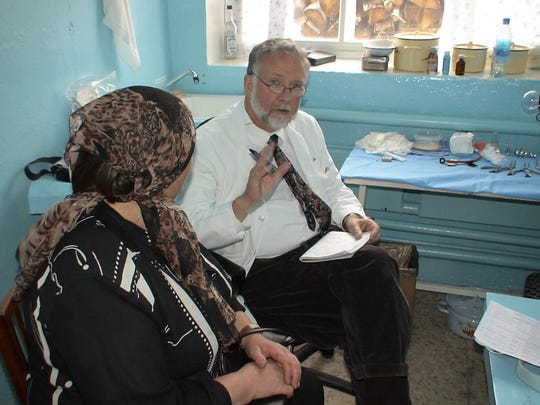 Dr. James Fuller talks to a patient in Siberia.