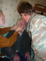 Dr. James Fuller treats a patient in Siberia.