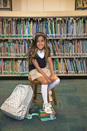 Taylor Reis, 8, models for the August 2018 issue of Southwest Florida Parent & Child magazine at J. Collin English Elementary School in North Fort Myers.